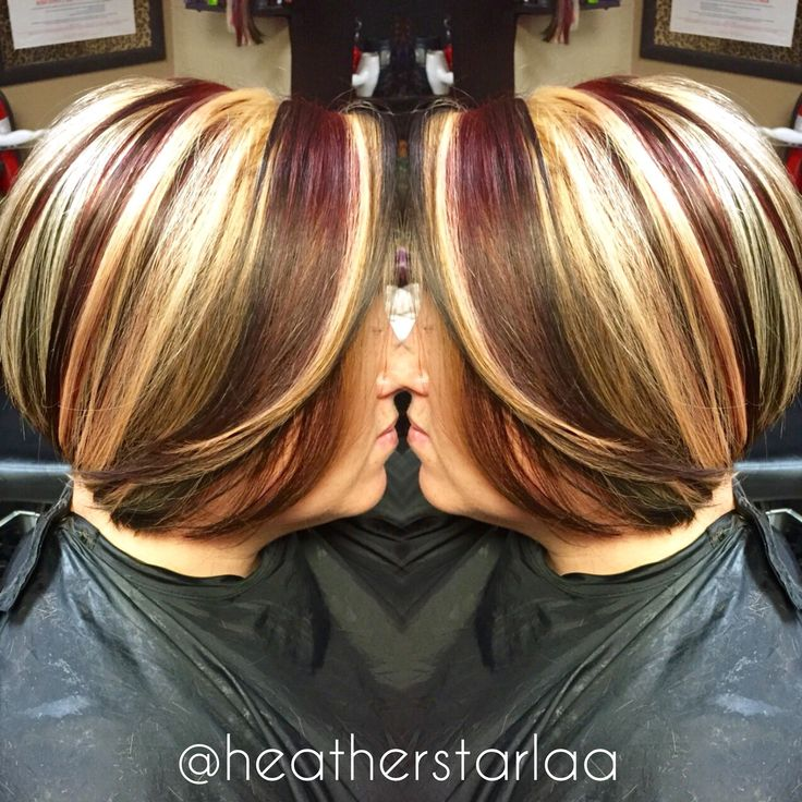 Chunky blonde and red highlights with s dark brown base on a short Aline haircut