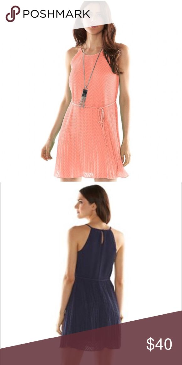 """Elle Coral Lined Pleated Trapeze Dress NWT ELLE peach coral pleated lined trapeze dress will make you feel fabulous! FEATURES: Textured mushroom-pleat design, Crewneck with button-back closure, Spaghetti straps, Lined Coordinating sash.  SIZING (approx) *M 38"""" (8-10), L 40"""" (12-14) *34 1/2"""" approx length  Dress & Lining 100% polyester *Machine Wash Elle Dresses Mini"""