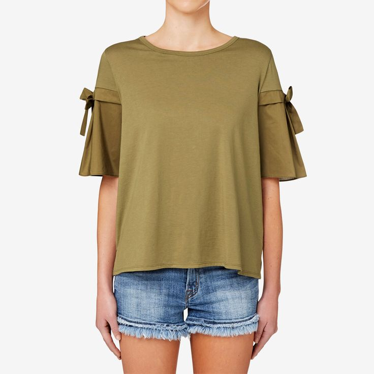 With a comfortable fitting silhouette and flowing body, this tee is perfect for a feminine style. Featuring bows at the sleeves, add casual shorts for an easy summer outfit or layer it underneath a leather jacket for a night out. Made from a cotton/modal blend, it