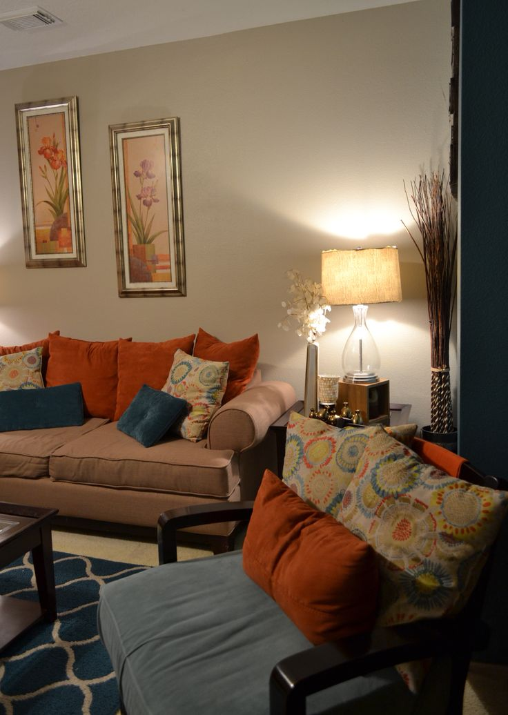 Accent wall rugs coffee table pillows teal orange - Orange walls living room ...