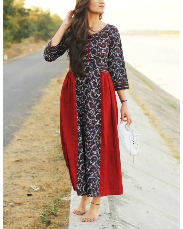 Indigo and red ajrakh dress    Gathered dress in indigo with ajrakh print. It has an indigo printed stripe at the center with red panels on the sides.