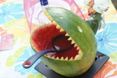 How to make a watermelon shark punch bowl by Offbeat Bride. Get a fish shaped ice cube tray and freeze sprite mixed with different colors of food coloring to make colorful fish to put in the punch! #YoyoBirthday