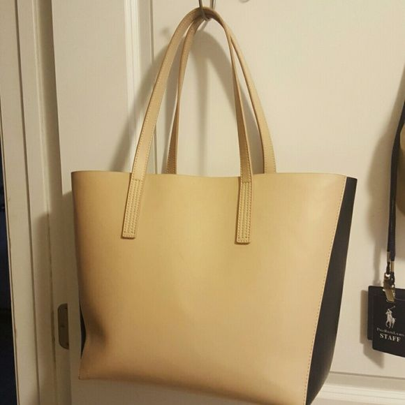 TODAY ONLY!!  J.Crew big handbag Tan And navy handbag.  Small stains on the bottom inside of the bag.  (shown in picture 3) No trades or holds.  Please ask all questions before purchasing.   I ship every day except Saturday and Sunday. J. Crew Bags