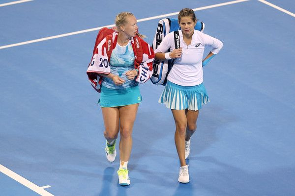 Julia Goerges Photos Photos - Timea Babos of Hungary and Andrea Hlavackova of the Czech Republic shake hands with Kiki Bertens of Netherlands and Julia Goerges of Germany after winning the Women's Doubles Quarterfinal match on day six of 2017 China Open at the China National Tennis Centreon October 5, 2017 in Beijing, China. 2017 China Open - Day 6