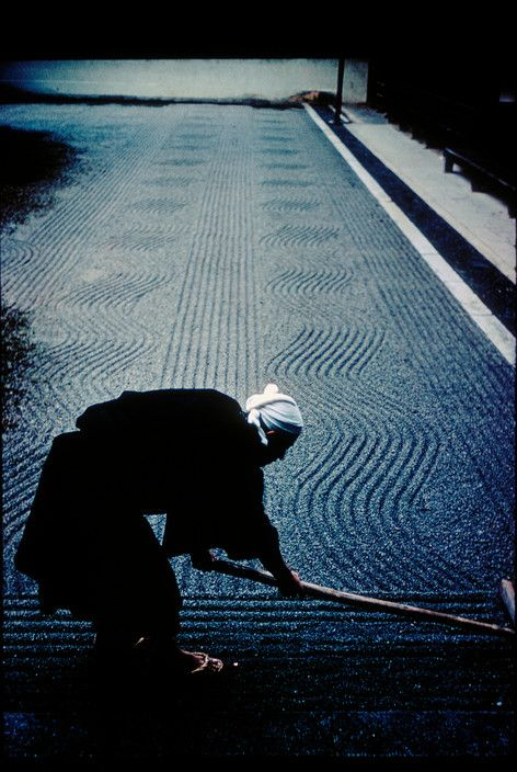 A monk arranges sand patterns in the rock garden of Ryoanji Temple, Kyoto, 1961 • Burt Glinn