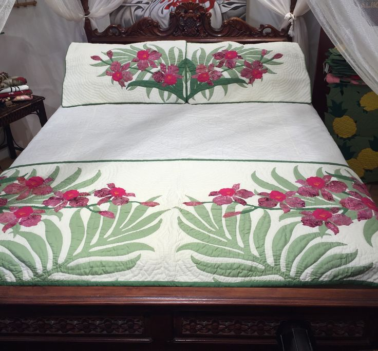 """26"""" x 88"""" stitched quilted bed runner and matching pillow shams, in assorted shades of pinks, purples and greens."""