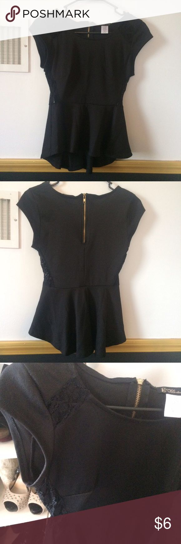 Black and lace peplum top Black peplum style with a gold zipper in the back. There is lace detailing on the sides and at the top Grass Collections Tops Blouses
