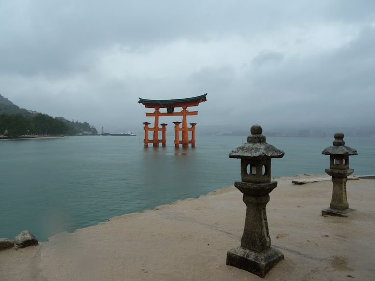 the tori gate at itsukushima seen from the waterfront
