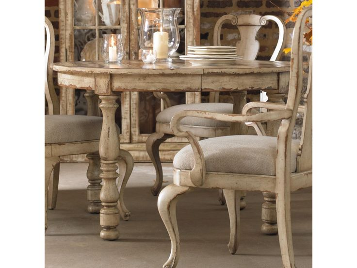 Surround yourself with sumptuous elegance found in this round leg dining table from the Wakefield collection.  Crafted from hardwood solids with cherry and pine veneers, this dining table offers a traditional style with a worn, rustic finish that is sure to make an eye-catching center in any eating area.  The fifteen-step finish showcases a unique taupe paint that is highly distressed to allow the cherry and pine wood undertones to shine through.  The classically turned table legs provide a…