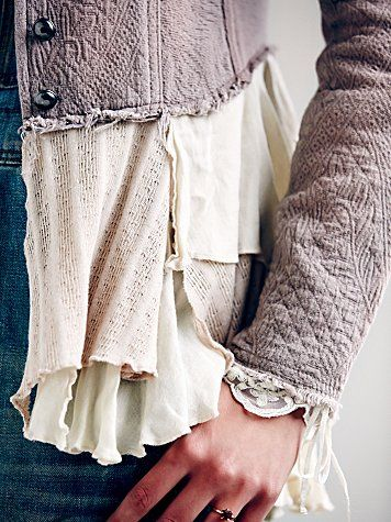 Cool combo! Love how they took a jacket and reconstructed it, adding ruffles and lace