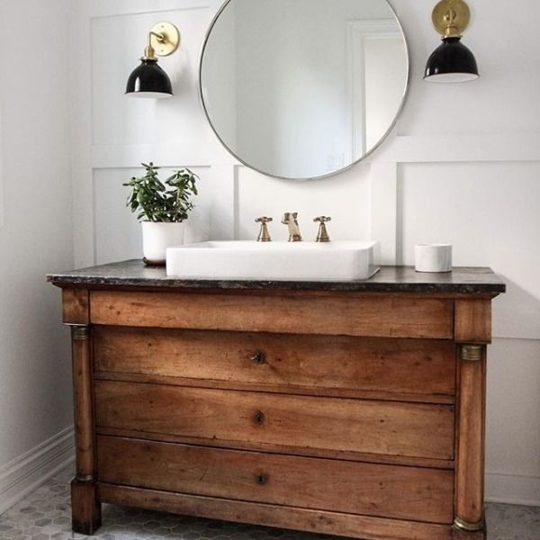 Love the industrial accents and brass hardware with this antique reclaimed wood vanity.