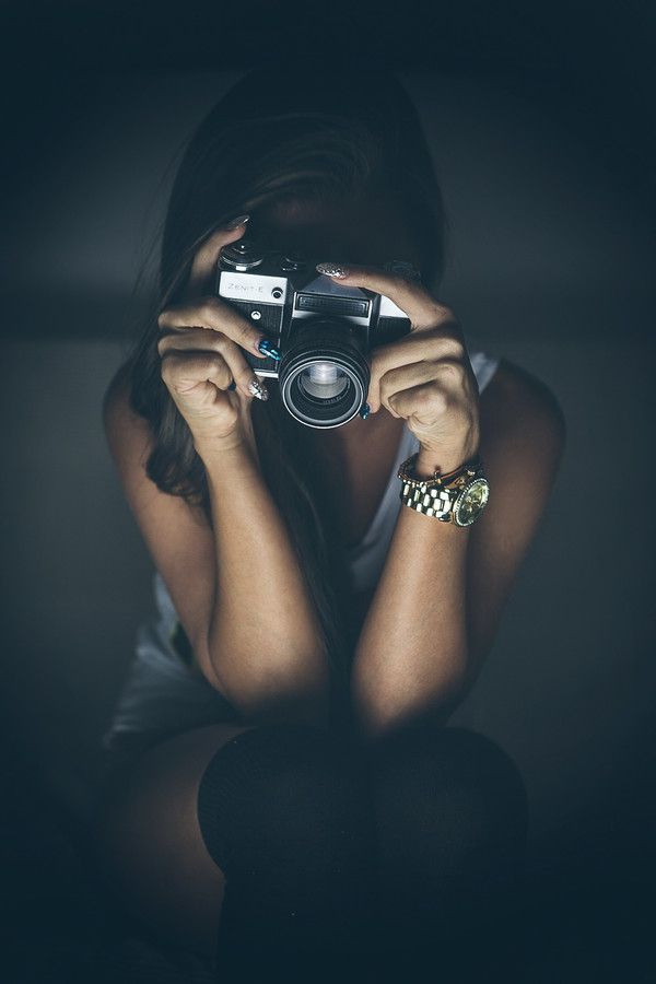 Photography by Peter Simon. Behind camera, camera, wrist watch, woman, female, arms, hands, focus, photograph, photo