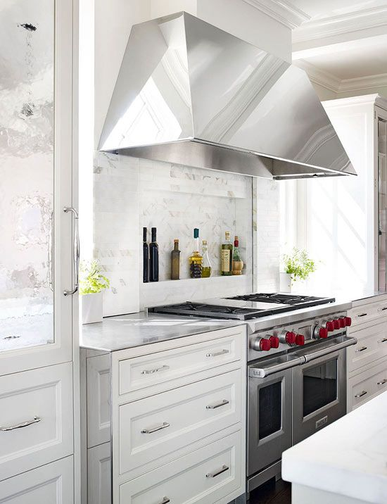 de Giulio Kitchen Design - Kitchen cooktop marble niche holds gourmet bottles of oils and vinegars.