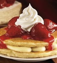 The IHOP Pancake Stackers consists of cheesecake filling surrounded by two buttermilk pancakes and topped with a strawberry, blueberry or ci...