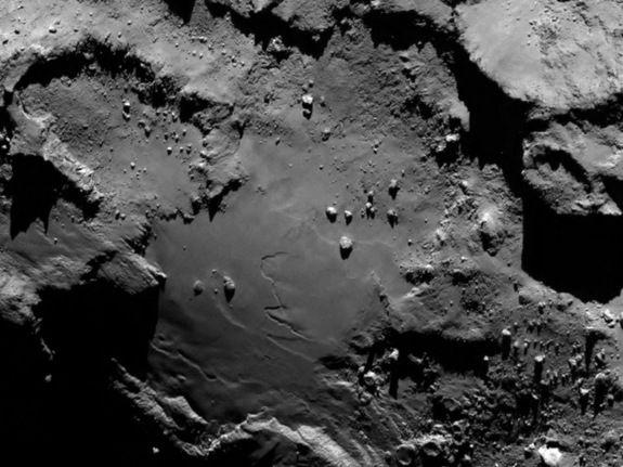 First Comet Close-Ups from Rosetta Spacecraft Reveal a 'Scientific Disneyland'  Comet 67P Details