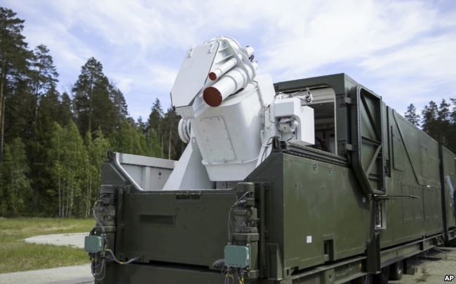 In this video grab provided by RU-RTR Russian television via AP television on March 1, 2018, a Russian military truck with a laser weapon mounted on it is shown at an undisclosed location in Russia.