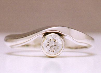 Driftwood #1: Driftwood engagement ring, curved 18k white gold, single .25ct center diamond.