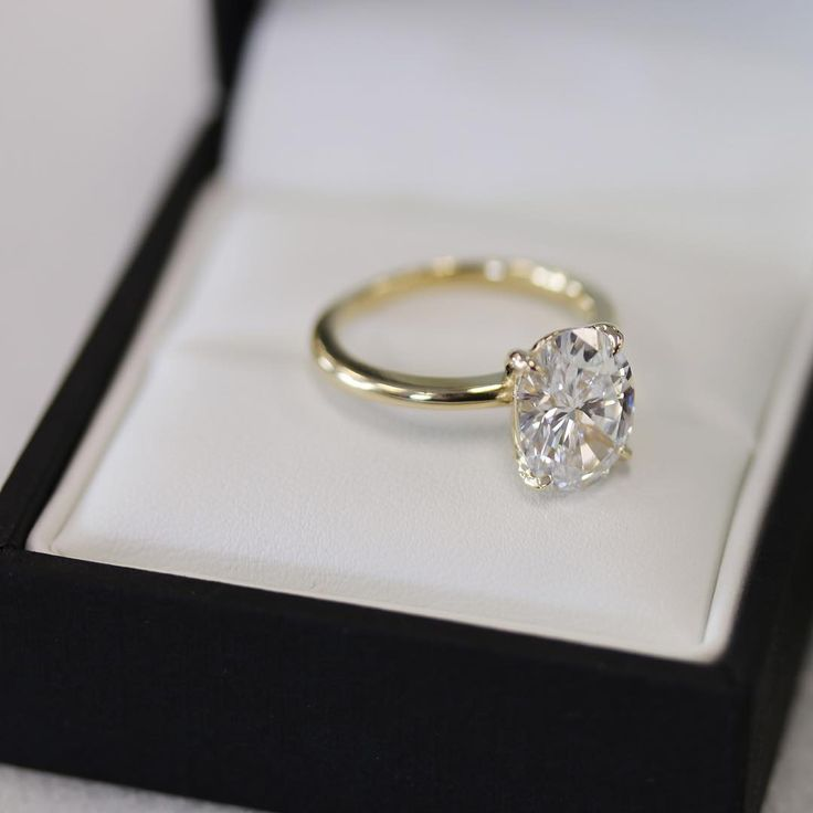 Four Prong Oval Solitaire engagement ring in yellow gold by Ada Diamonds This ring features an absolutely spectacular 2.51 carat D VVS2 Oval Diamond.