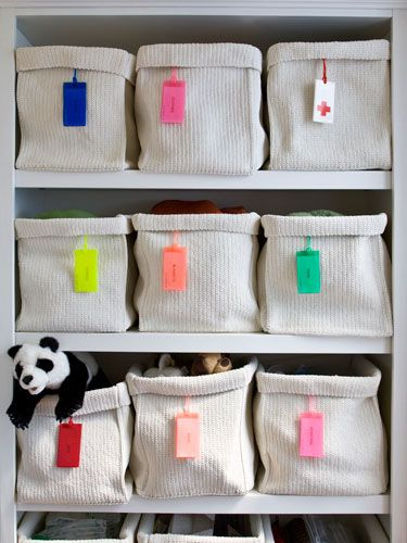 Luggage tags are an easy way to label baskets.   52 Meticulous Organizing Tips For The OCD Person In You