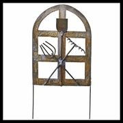 """$7.99 Miniature garden gate with easy-stick-in-soil picks on either side, with decorative tools on face to announce: """"a secret garden lies beyond"""".       Dimensions: 4.5"""" high (excluding length of pick) x 3.25"""" wide     Made of: Tin"""