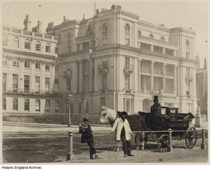 OP31119 A man and a boy leaning against a railing next to a horse and carriage on King's Road, with the south front of the Bedford Hotel behind. Figures can be seen climbing up tall ladders around the hotel's exterior. City of Brighton and Hove. c1860 - 1890. Please click for more information, or to search the collection.