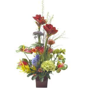 Este centro está compuesto de amaryllis, proteas, tulipanes, cymbidium, anturium, hortensias y jacintos | Bourguignon Floristas