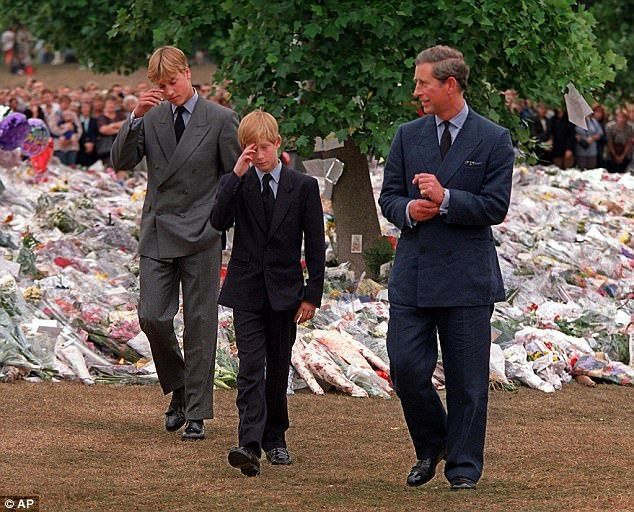 Harry, 12, and William, 15, visit floral tributes to their mother at Kensington Palace wit...