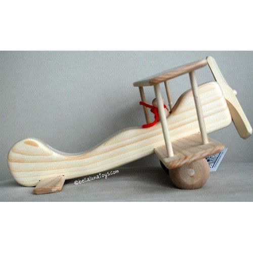 "This charming Wooden Toy Airplane is handcrafted in Maine of native white pine and hand sanded to a satin smooth, natural finish. This bi-plane model includes a removable red-scarfed ""Red Baron"" pilot"