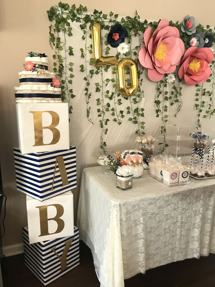 Baby Shower floral decor. 'BABY' blocks and large paper flower DIY