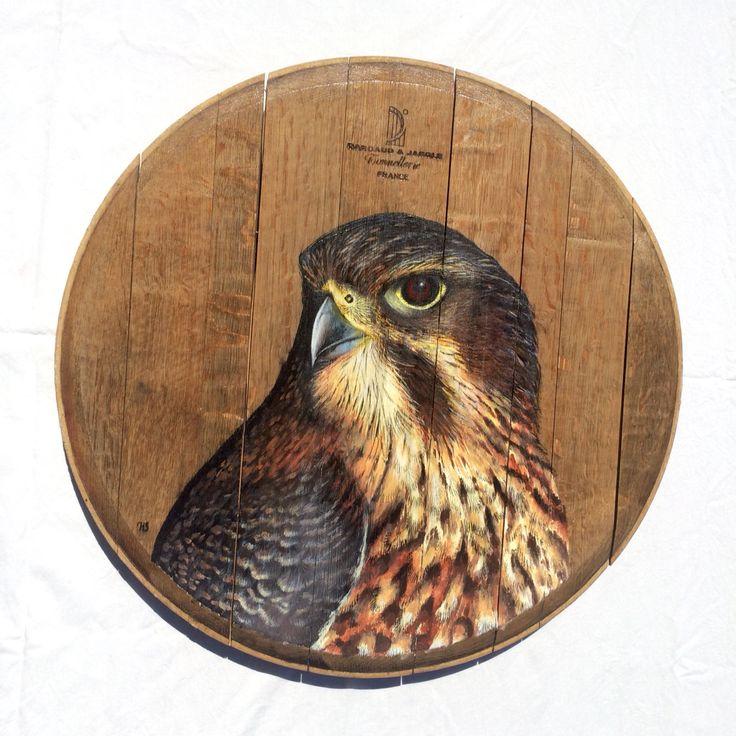 The falcon on recycled oak wine barrel lid. www.hannahstarnesart.co.nz