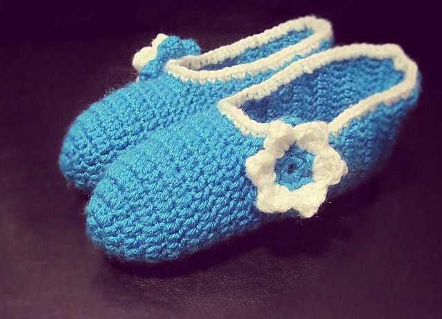More slippers! I'm on a real slipper kick right now.. No real pattern for this  http://www.etsy.com/shop/CowlandCompany