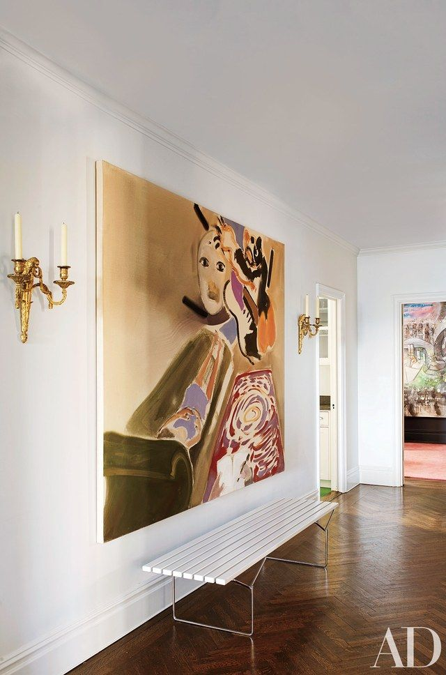 It only takes one great piece of art to make a room great, as this entrance hallway of a New York City apartment shows.
