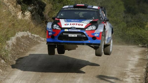 Lotos World Rally Team driver Robert Kubica getting airtime in his Ford Fiesta WRC car.