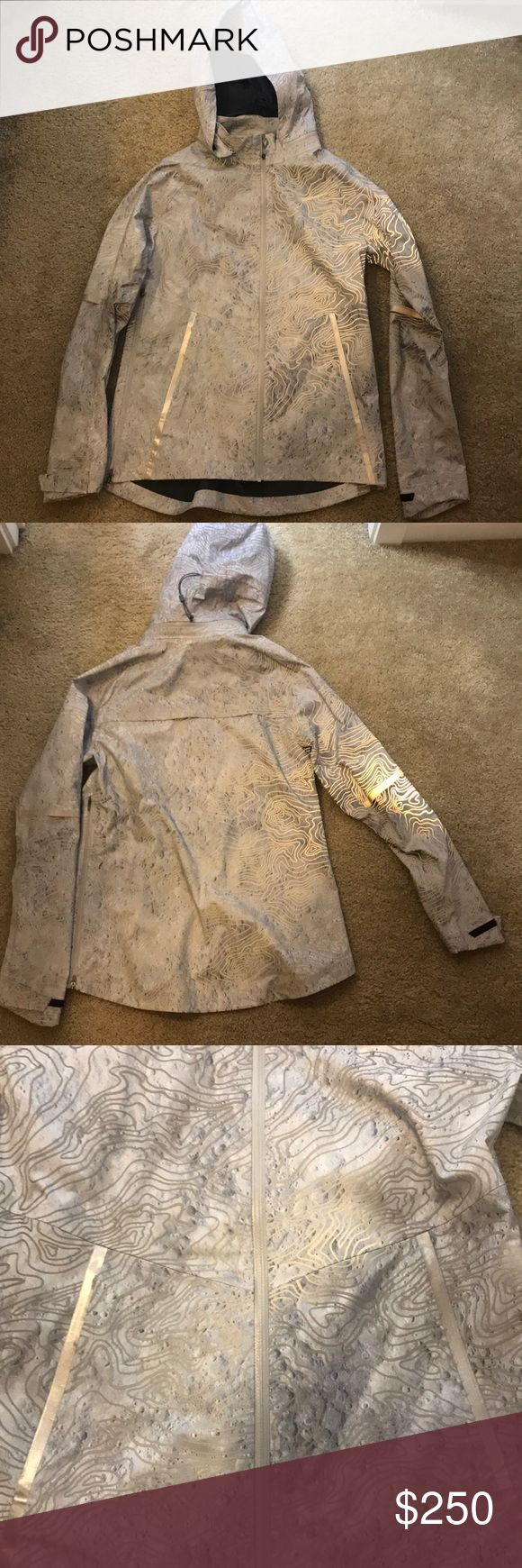 Nike Running Jacket Never used, great condition, glows in the dark, silver color Nike Jackets & Coats