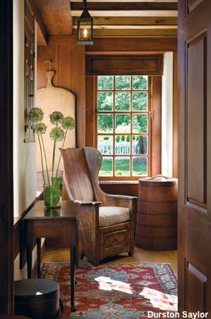 Two Bucks County designers restore a dilapidated country estate to its Colonial glory, and call it Peaceable Farms. Here, original window panes let light into the kitchen nook.