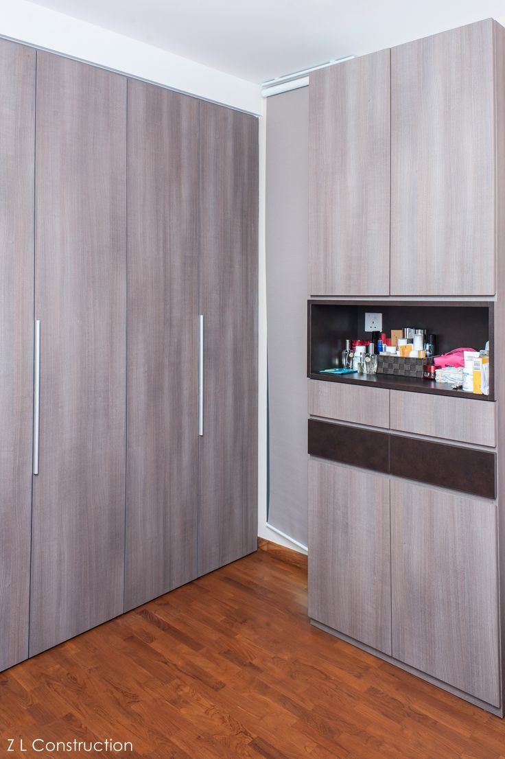 Z L Construction (Singapore) \\ Wood-grained laminated wardrobe with dark brown drawers and niche
