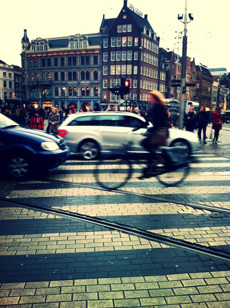 Girl on bike, de Dam - Amsterdam. The Netherlands 2013.