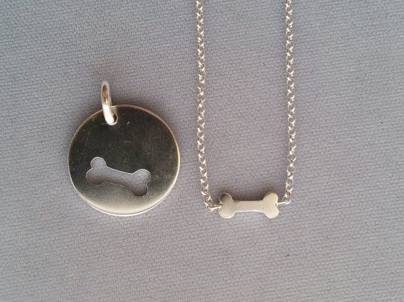 Is your dog your BFF? Why not express that bond with an extra special matching necklace set that fits together.  The jump rings on the dog tag are soldered closed for extra security, so they wont open during playtime. Round dog collar tag is 1 in diameter and the bone pendant is about 1/2 wide. The necklace comes on an 18 chain. The pieces are saw-pierced, and each set may vary slightly due to the handmade nature of the technique.   This tag is the perfect gift for you and your pet, or f...