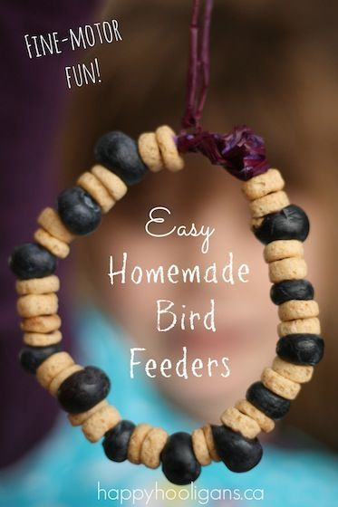 Homemade bird feeders with cheerios and blueberries - a fine motor activity