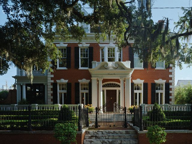 Traditional Red Brick Home With Wrought Iron Fence American Style House Dream House Exterior