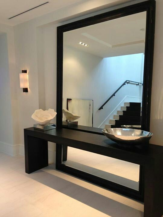 Minimalist lobby, I like its simplicity giving prominence to large mirror.