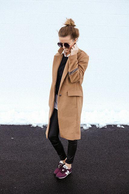 camel coat + gray + black skinny jeans + purple Nike sneakers