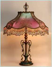 Antique 1920s era metal lamp base has been hand-painted and holds a hand-dyed Turkish Starling silk lampshade.
