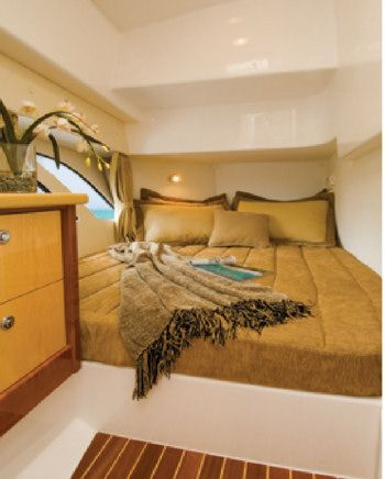 Intrepid 475 Sport Yacht: The guest stateroom also has the high overhead, an opening hatch, teak and holly sole, and hull-side windows.