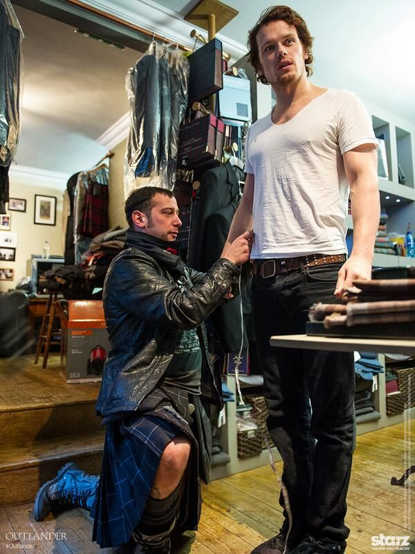 Sam Heughan being fitted for his kilt.