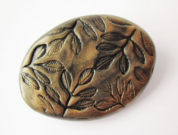 Large brooch black and gold oval polymer clay scarf pin by Lagneys, £10.00