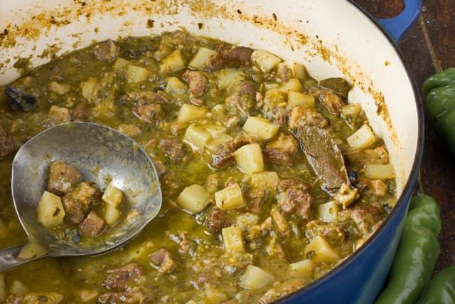 There's nothing I love more than having a mammoth-sized batch of soup on the stove, whether it's going to serve a room full of people or supply me with a stockpile of meals. This New Mexico pork and green chile stew is the perfect candidate to make on a lazy Sunday and then live off of the rest of the week. It's spicy, savory, and hearty, and just when you think it can't get any better, it does!