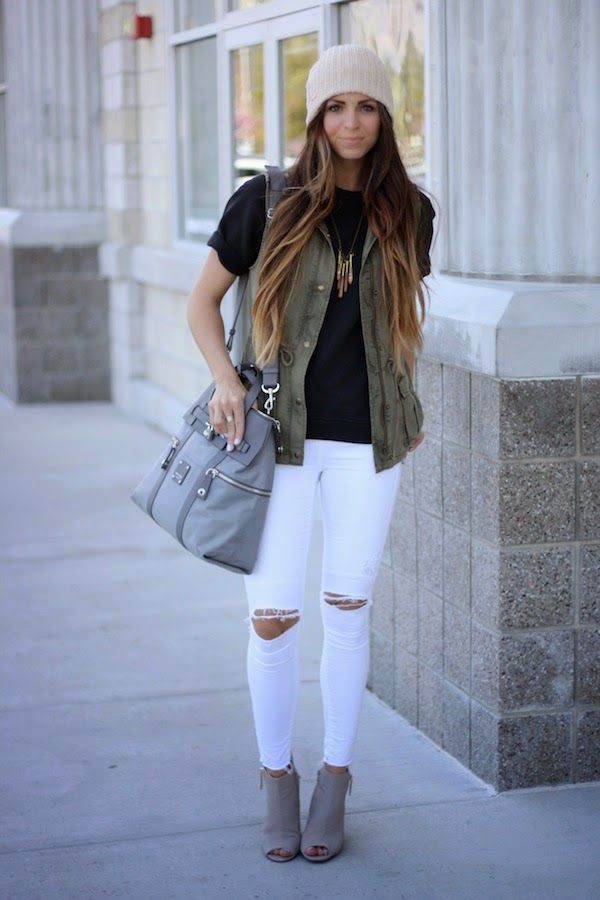 black tee, army green vest, white ripped jeans, tan booties, grey bag, and cream beanie