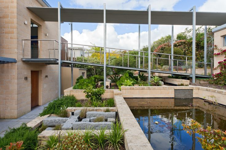 Large rectangular pond with aquatic plants.  www.outdoorcreations.com.au