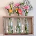 Pallet wood and glass coke bottles used to create a wall mounted vase! | Recycled Crafts | Pinterest | Pallet wood, Left over and Glasses